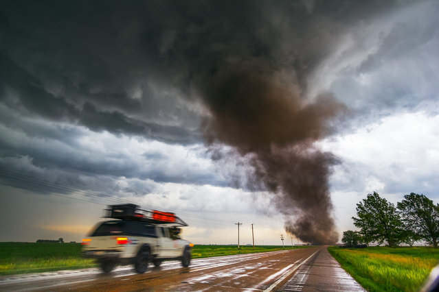 Tornado from a tornadic supercell approaches from the south, west of York Nebraska June 20, 2011. (Photo by Mike Hollingshead)