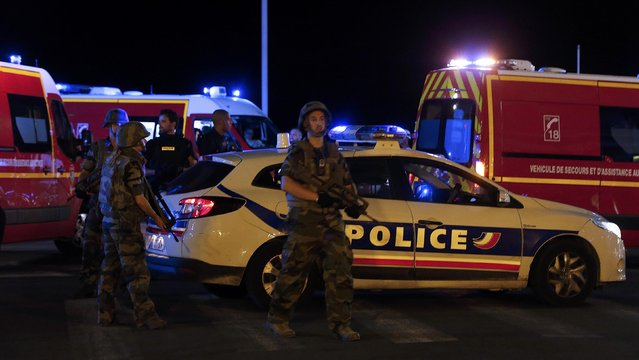 French soldiers and rescue forces are seen at the scene whare at least 30 people were killed in Nice, France, when a truck ran into a crowd celebrating the Bastille Day national holiday July 14, 2016. (Photo by Eric Gaillard/Reuters)