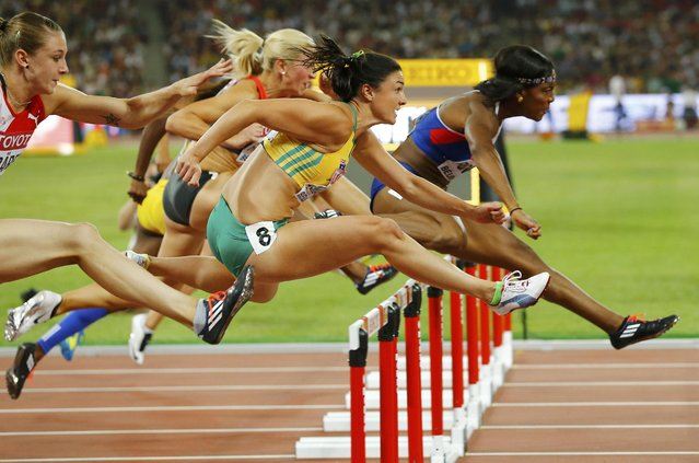 Tiffany Porter of Great Britain (R) clears a hurdle ahead of Michelle Jenneke of Australia in the women's 100 metres hurdles semi-final during the 15th IAAF World Championships at the National Stadium in Beijing, China August 28, 2015. (Photo by Damir Sagolj/Reuters)