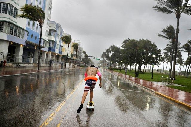 Funky Matas skateboards along South Beach as the effects of Hurricane Irma are felt in Miami Beach, Fla., Saturday, September 9, 2017. (Photo by David Goldman/AP Photo)