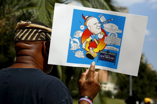 """A marcher in the African American Leadership Project's """"Hands Around the Superdome"""" marches while carrying a sign comparing New Orleans Mayor Mitch Landrieu to Pinocchio, in New Orleans, Louisiana August 29, 2015. (Photo by Edmund D. Fountain/Reuters)"""