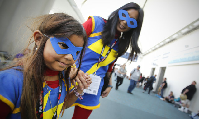 A mother and her six-year-old daughter as matching Ms Marvels during opening day of the annual Comic-Con International in San Diego, California, United States July 21, 2016. (Photo by San Diego Union/Rex Features/Shutterstock)