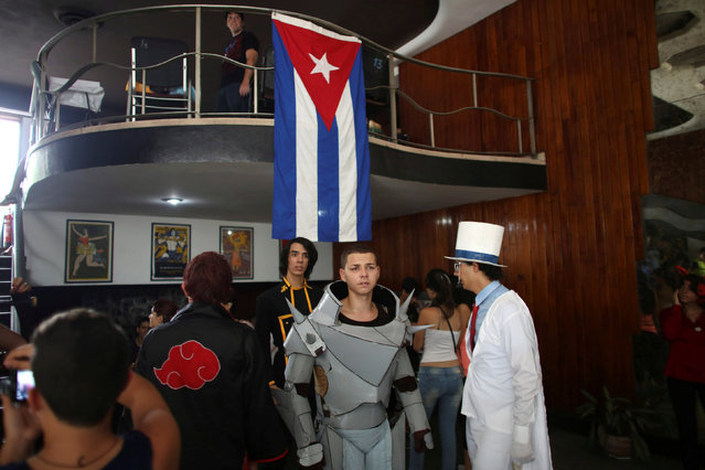 Participants are seen at the entrance of a cinema where the Cuban Otaku festival is taking place in Havana, Cuba, July 24, 2016. (Photo by Alexandre Meneghini/Reuters)