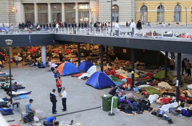 Migrants sleep near the Keleti railway station in Budapest, Hungary, September 3, 2015. Over 2,000 migrants, many of them refugees from conflicts in the Middle East and Africa, had been camped in front of the Keleti Railway Terminus, closed to them by authorities saying European Union rules bar travel by those without valid documents. (Photo by Bernadett Szabo/Reuters)