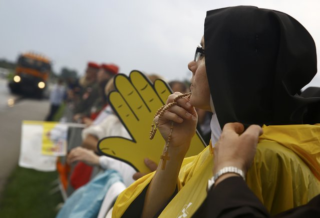 A nun holds a rosary as she waits for Pope Francis farewell ceremony at Balice airport near Krakow, Poland July 31, 2016. (Photo by Kacper Pempel/Reuters)