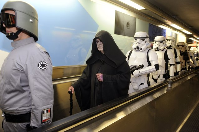 Participants wearing Star Wars costumes are seen at the Parc metro station after the Balloon's Day Parade in Brussels September 6, 2014. (Photo by Eric Vidal/Reuters)