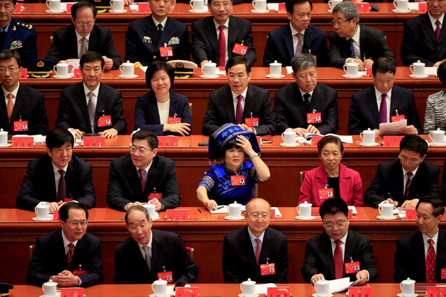 Delegates prepare for the opening of the 19th National Congress of the Communist Party of China at the Great Hall of the People in Beijing, China October 18, 2017. (Photo by Aly Song/Reuters)