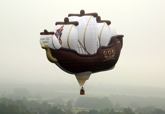 A 128ft wide hot air balloon in the shape of a galleon, which has been commissioned by Captain Morgan, flies close to Highgrove House near Tetbury in Gloucestershire on September 14, 2014, to celebrate Prince Harry's 30th birthday. (Photo by Geoff Caddick/PA Wire)