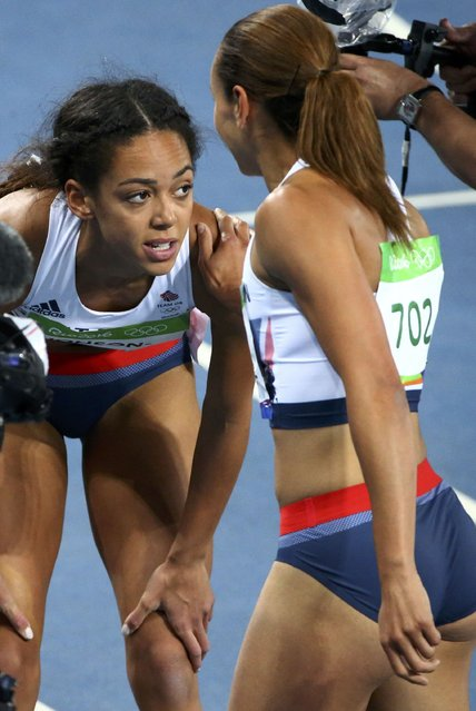 2016 Rio Olympics, Athletics, Preliminary, Women's 200m Round 1, Olympic Stadium, Rio de Janeiro, Brazil on August 12, 2016. Katarina Johnson-Thompson (GBR)and Jessica Ennis-Hill (GBR) of Britain react. (Photo by David Gray/Reuters)