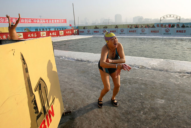 Winter swimmers performer at a pool carved out of the frozen Songhua river during the 22nd Harbin International Ice and Snow Festival on January 11, 2006 in Harbin, Heilongjiang Province in north China. Harbin is one of China's coldest cities and each winter hosts an ice festival, with famous buildings and landmarks from around the world recreated in ice. (Photo by Cancan Chu)