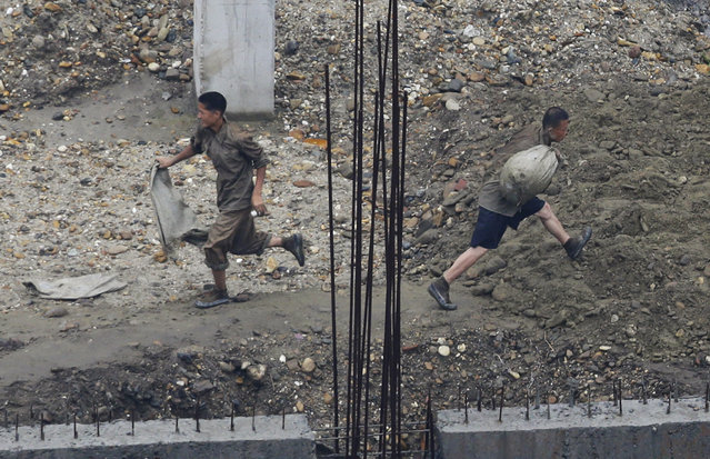 Laborers work at a construction site in Pyongyang, July 28, 2013. (Photo by Jason Lee/Reuters)