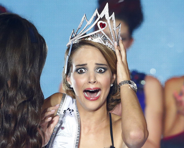 Miss Switzerland 2014 Laetitia Guarino reacts after she won the Miss Switzerland beauty pageant on the Federal Square in Bern October 11, 2014. (Photo by Ruben Sprich/Reuters)