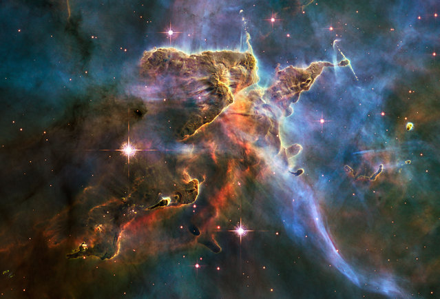 The tempestuous stellar nursery called the Carina Nebula, located 7,500 light-years away from Earth in the southern constellation Carina. (Photo by Reuters/NASA)