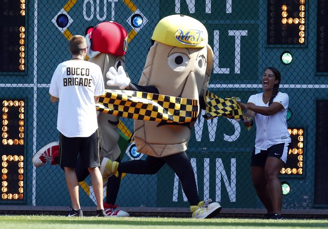 Potato Pete crosses the finish line in first place during the Pittsburgh Pierogy race during the game against the Milwaukee Brewers at PNC Park on September 4, 2015 in Pittsburgh, Pennsylvania. (Photo by Justin K. Aller/Getty Images)