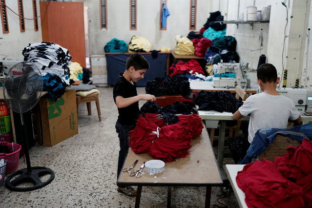 Syrian refugee boys work at a small textile factory in Gaziantep, where they are employed by a 30-year-old Turk who gave his name as Selim, in Turkey, May 16, 2016. (Photo by Umit Bektas/Reuters)