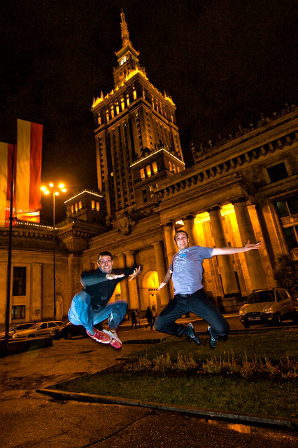 """Jumpology"". ""Double jump! Éole and Jérém in front of the Palace of Culture in Warsaw, Poland"". (Photo by Éole Wind)"