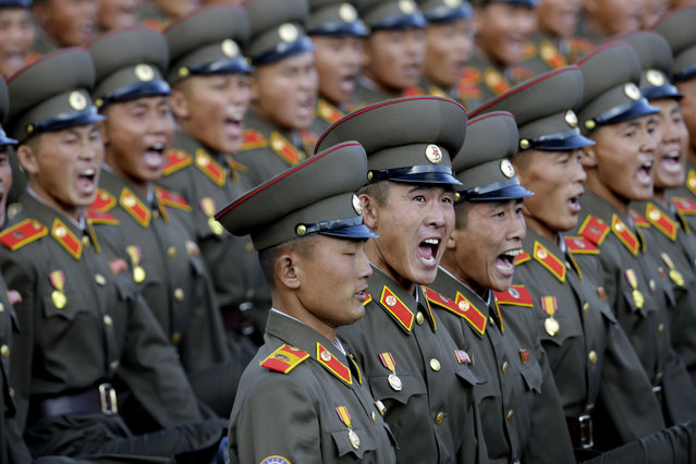 North Korean soldiers parade in Pyongyang, North Korea, Saturday, October 10, 2015. North Korea is holding one of its biggest celebrations for the 70th anniversary of its ruling party's creation. (Photo by Wong Maye-E/AP Photo)