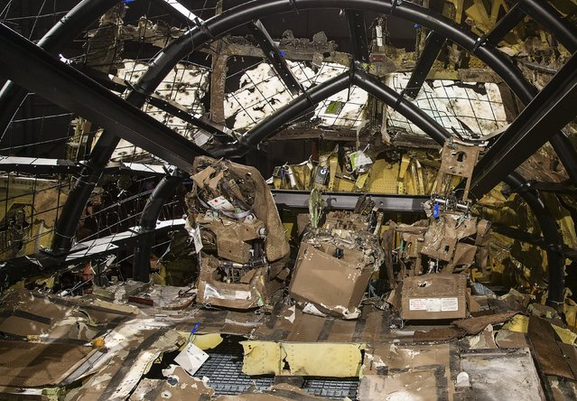 The reconstructed cockpit of the Malaysia Airlines Flight MH17 is seen after the presentation of the final report regarding its crash, in Gilze Rijen, the Netherlands, October 13, 2015. (Photo by Michael Kooren/Reuters)