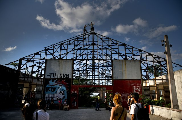In this January 11, 2018 photo, people arrive to an abandoned gym recently converted into a space for skateboarders, the day of its inauguration inside the Educational complex Ciudad Libertad, a former military barracks that the late Fidel Castro turned into a school complex after the revolution in Havana, Cuba. Cuba's small but exuberant skateboard movement has carved out a new space for itself, helped by a Cuban-American skate shop owner. (Photo by Ramon Espinosa/AP Photo)