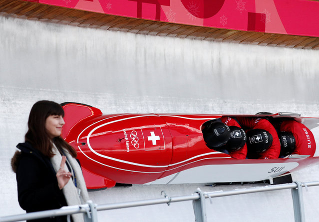 Driver Rico Peter, Michael Kuonen, Simon Friedli and Thomas Amrhein of Switzerland take a curve during training for the four- man bobsled competition at the 2018 Winter Olympics in Pyeongchang, South Korea, Friday, February 23, 2018. (Photo by Edgar Su/Reuters)