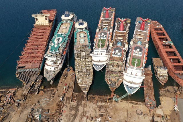 A drone image shows decommissioned cruise ships being dismantled  for scrap metal sales after the COVID-19 pandemic all but destroyed the industryat Aliaga ship-breaking yard in the Aegean port city of Izmir, western Turkey, October 2, 2020. (Photo by Umit Bektas/Reuters)