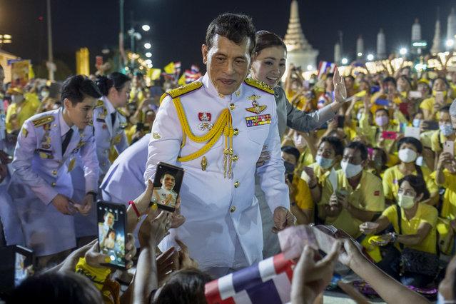 King Maha Vajiralongkorn and Queen Suthida greet supporters in Bangkok, Thailand, Sunday, November 1, 2020. (Photo by Wason Wanichakorn/AP Photo)