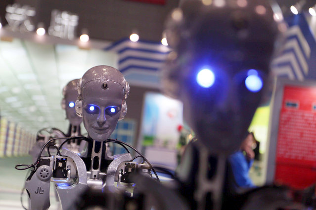 A robot performs drawing during the 17th China International Industry Fair in Shanghai, China, 3 November 2015. The 17th China International Industry Fair opened Tuesday (3 November 2015) at the Shanghai National Exhibition and Convention Center. More than 2,100 exhibitors participated in the five-day fair which is expected to attract 120,000 visitors. (Photo by Imaginechina/Splash News)