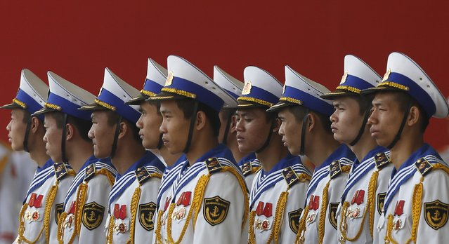 Members of the naval guard of honour stand during celebrations to commemorate the 70th anniversary of the establishment of the Vietnam People's Army at the National Convention Center in Hanoi December 20, 2014. (Photo by Reuters/Kham)
