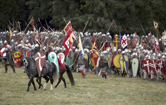 Re-enactors participate in a re-enactment of the Battle of Hastings, commemorating the 950th anniversary of the battle, in Battle, Britain October 15, 2016. (Photo by Neil Hall/Reuters)