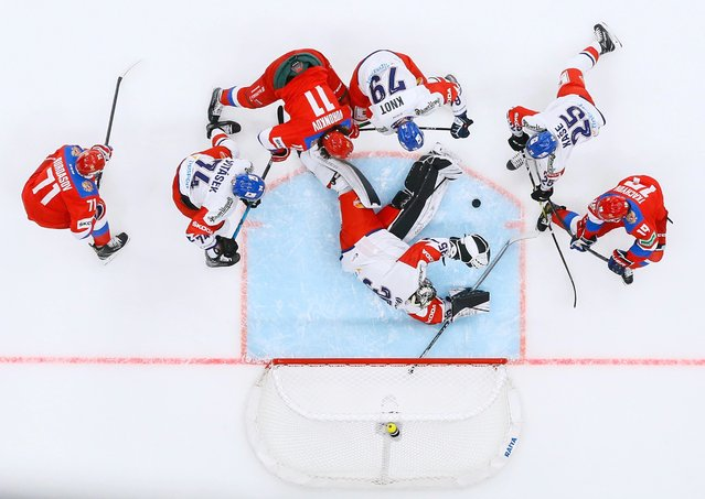 Russian and Czech ice hockey players take part in a goalmouth scramble during their Euro Hockey Tour match at Park of Legends Arena in Moscow on December 19, 2020. (Photo by Evgenia Novozhenina/Reuters)