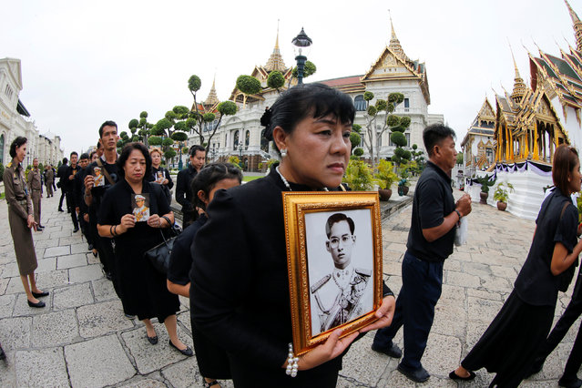 Mourners line up to get into the Throne Hall at the Grand Palace for the first time to pay their respects in front of the golden urn of Thailand's late King Bhumibol Adulyadej in Bangkok, Thailand, October 29, 2016. (Photo by Jorge Silva/Reuters)
