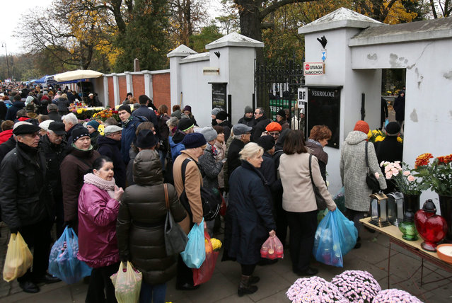 People are queuing to enter the Powazki Cemetery in Warsaw, Poland, 01 November 2016. Millions of Poles are visting cemeteries on the All Saints' Day to commemorate their deceased relatives and loved ones. All Saints' Day is observed on the 1st of November by the Roman Catholic Church and Protestant churches. (Photo by Leszek Szymanski/EPA)