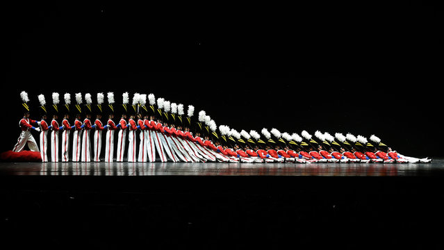 "The Rockettes tumble down in the ""Parade of the Wooden Soldiers"" during the 2015 Radio City Christmas Spectacular at Radio City Music Hall  December 2, 2015. The Radio City Christmas Spectacular has been hosted annually at the Radio City Music Hall since 1933. The 2015 Radio City Christmas Spectacular takes place from November 13, 2015 through January 3, 2016. (Photo by Timothy A. Clary/AFP Photo)"