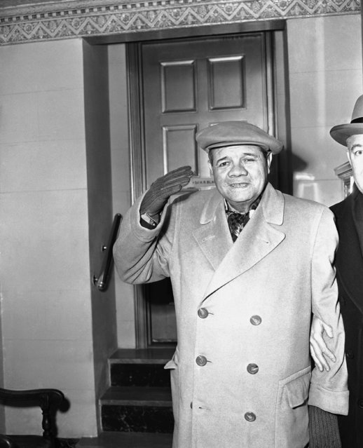 Babe Ruth waves as he arrives at his home at 110 Riverside Drive in New York, January 27, 1948, from the Neurological Institute of the Columbia Presbyterian Medical Center. He had been in the hospital for a check-up since Jan. 10.  He plans to leave for Florida by train, Jan. 29, for a three or four weeks vacation. (Photo by John Rooney/AP Photo)