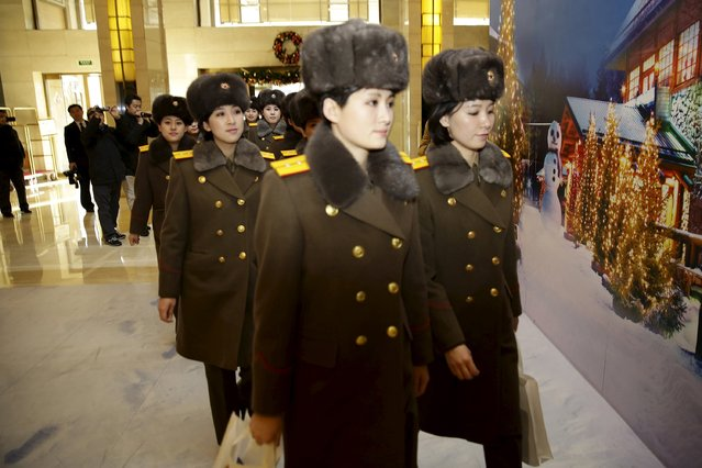 Members of the Moranbong Band from North Korea arrive at a hotel in central Beijing, China, December 11, 2015. (Photo by Reuters/Stringer)