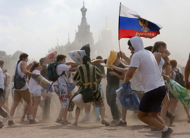 People engage in a pillow battle flash mob in St. Petersburg, Russia, on June 29, 2013. (Photo by Dmitry Lovetsky/Associated Press)