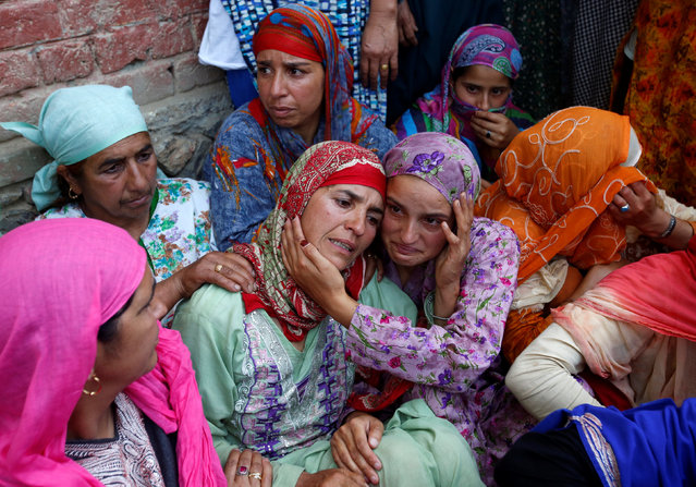Relatives of 16-year-old girl Andleeb Jan, a civilian who according to local media died during clashes between protesters and Indian security forces, mourn during her funeral in South Kashmir's Kulgam district, July 7, 2018. (Photo by Danish Ismail/Reuters)