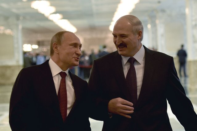 Russia's President Vladimir Putin (L) reacts as he talks to Belarus' President Alexander Lukashenko before a meeting on resolving the Ukrainian crisis in Minsk, February 11, 2015. (Photo by Mykola Lazarenko/Reuters)
