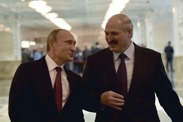 Russia's President Vladimir Putin (L) reacts as he talks to Belarus' President Alexander Lukashenko before a meeting on resolving the Ukrainian crisis in Minsk, February 11, 2015. (Photo by Mykola Lazarenko/Reuters)
