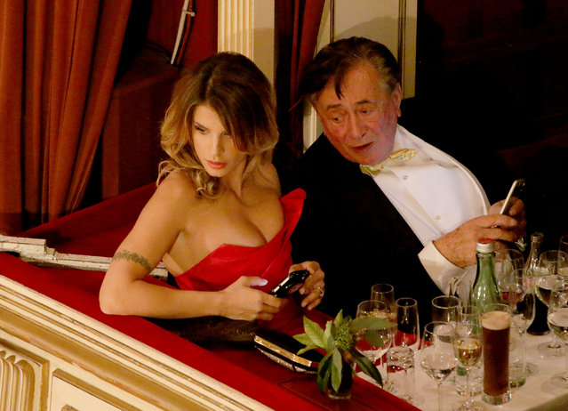 Italian actress Elisabetta Canalis and her host Austrian businessman Richard Lugner, watch the as the traditional Opera Ball gets underway in Vienna, Austria, Thursday, February 12, 2015. The Opera Ball is one of the most privileged events in the Austrian social calendar, attracting invited local guests along with luminaries and international dignitaries. (Photo by Ronald Zak/AP Photo)