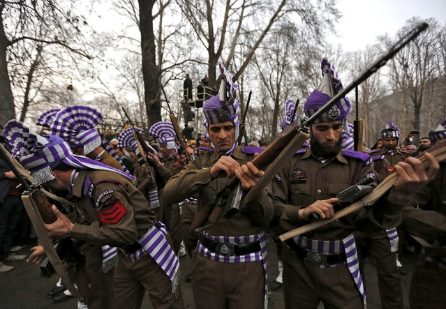 Indian policemen get ready to give a gun salute during the funeral of the chief minister of Jammu and Kashmir Mufti Mohammad Sayeed in Srinagar, January 7, 2016. The leader of India's insurgency-plagued Jammu and Kashmir state and an ally of Prime Minister Narendra Modi died on Thursday, bringing political uncertainty to the disputed region at the heart of tension between India and Pakistan. Sayeed, 79, died of a respiratory infection after spending the last two weeks in hospital in New Delhi, a spokesman for his Peoples Democratic Party (PDP) said. (Photo by Danish Ismail/Reuters)
