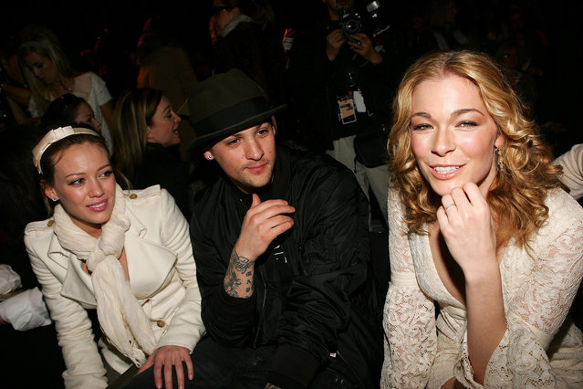 (L-R) Hilary Duff, Joel Madden and LeAnn Rimes  attend the Michael Kors Fall 2006 fashion show at Bryant Park during Olympus Fashion Week in New York City. (Photo by Evan Agostini/Getty Images)