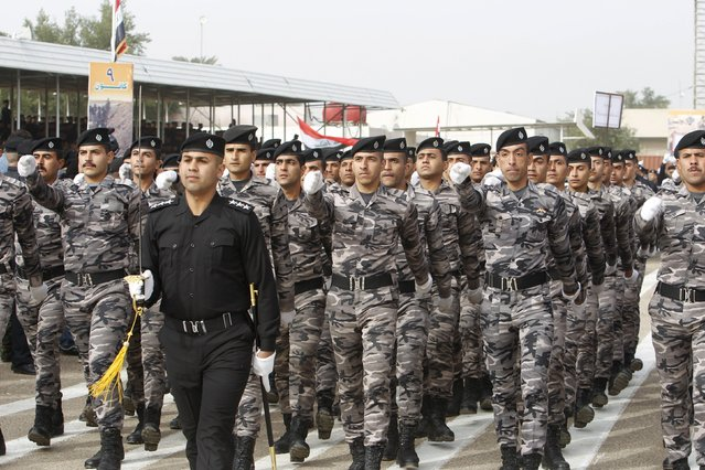 Troops of the Interior Ministry march in a parade during a ceremony marking the Iraqi Police Day at a police academy in Baghdad January 9, 2016. (Photo by Khalid al Mousily/Reuters)
