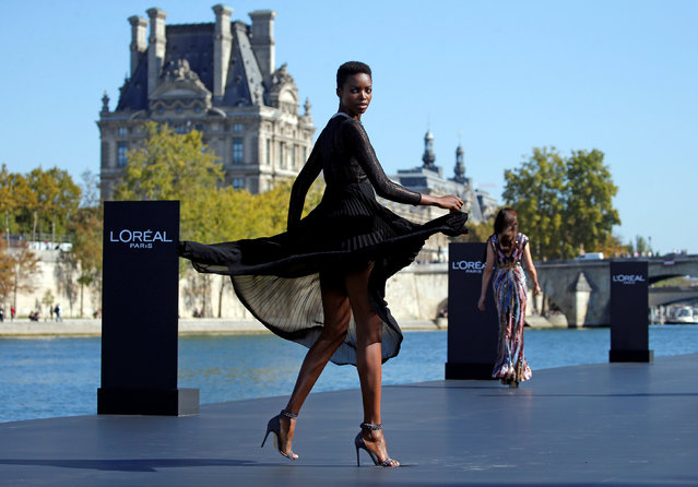 A model Maria Borges presents a creation on a giant catwalk installed on a barge on the Seine River during a public event organized by French cosmetics group L'Oreal as part of Paris Fashion Week, France, September 30, 2018. (Photo by Stephane Mahe/Reuters)