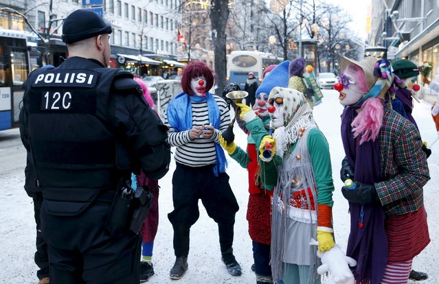 Anti-racist Loldiers of Odin clowns speak with police as they take to the streets against anti-immigration marchers in Tampere, Finland January 23, 2016. Police prevented the groups from confronting each other. On the northern fringes of Europe, Finland has little history of welcoming large numbers of refugees, unlike neighbouring Sweden. But as with other European countries, it is now struggling with a huge increase in asylum seekers and the authorities are wary of any anti-immigrant vigilantism. (Photo by Kalle Parkkinen/Reuters/Lehtikuva)