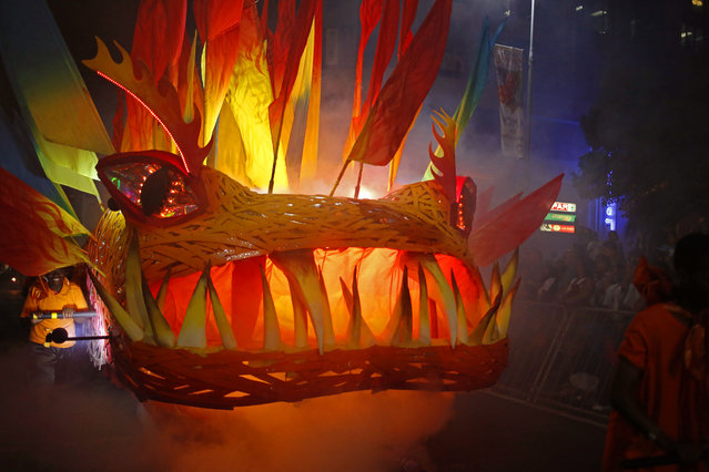 A monster float  takes part in the yearly Cape Town Carnival held in the city of Cape Town, South Africa, Saturday, March 14, 2015. Thousands of South African and tourist gather to see the yearly Cape Town Carnival bringing in thousands of revenue for the City. (Photo by Schalk van Zuydam/AP Photo)