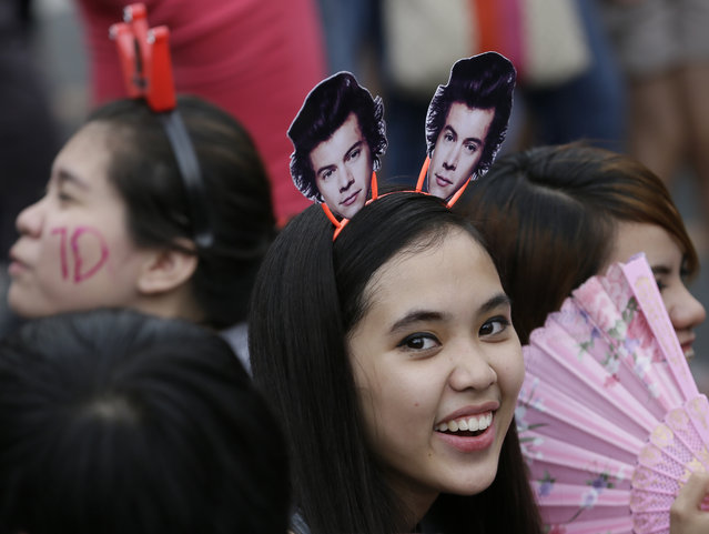 A Filipino fan lines up for the One Direction concert Saturday, March 21, 2015 in the suburban Pasay city south of Manila, Philippines. (Photo by Bullit Marquez/AP Photo)
