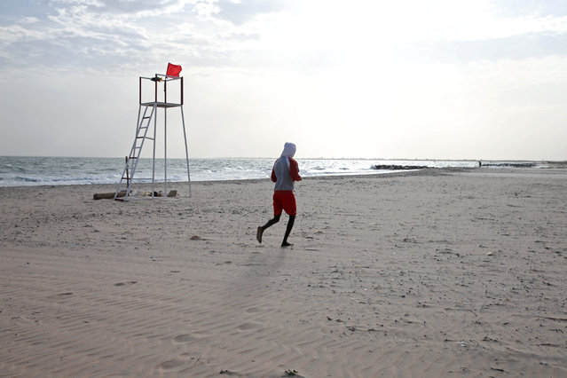 GAMBIA: A man jogs on the beach in Bakau, Gambia December 15, 2016. (Photo by Afolabi Sotunde/Reuters)