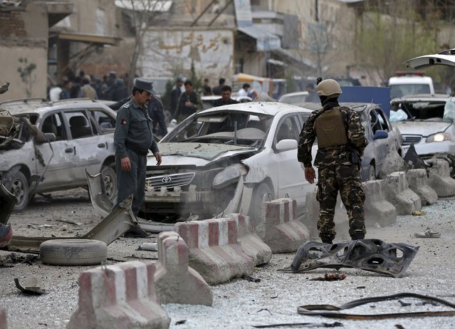 Afghan security forces inspect the site of a suicide attack in Kabul March 25, 2015. (Photo by Omar Sobhani/Reuters)