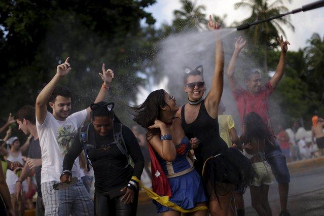 Revellers attend a carnival party in a neighborhood in Olinda, Brazil February 7, 2016. (Photo by Ueslei Marcelino/Reuters)